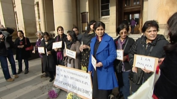 Women stand in Vigil for Malala