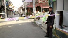A policeman is seen at the site of one of two bomb blasts in Hua Hin on Thursday.