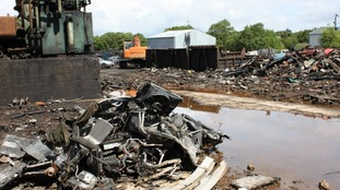 The 15-acre scrapyard littered with tyres, oil and car parts