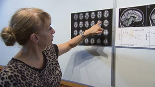 Professor Greenfield examines brain scans as she looks into the effects of technology.