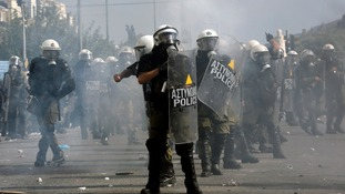 Riot police officer take position