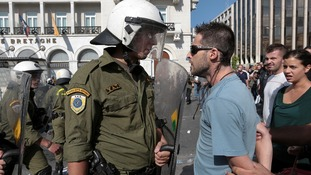 Riot police confronts protester