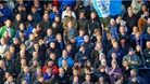 Fans supporting Portsmouth at Fratton Park