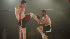 Brendan Loughnane and Eden Newton battle in the cage