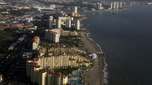 Gunmen abduct up to 16 people from Mexican beach resort