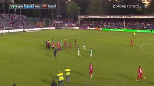 Goalkeeper attacked by masked pitch invader during Swedish football match