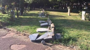 Scores of gravestones desecrated in 'appalling' vandalism at west London cemetery