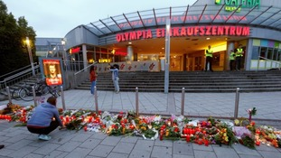 Flowers left outside the Olympia shopping in Munich.