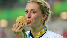 Laura Trott kisses the gold medal she won in the omnium.
