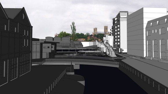 Proposed bridge at Brayford level crossing viewed against the cathedral