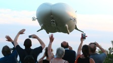 The Airlander 10, the largest aircraft in the world, during its maiden flight from Cardington airfield in Bedfordshire.