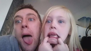 dad and daughter pull faces