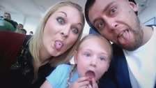 family pulling faces
