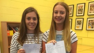 Ceri Sargent (L) and Holly Roddis collecting their A level results at Ullswater Community College in Penrith.