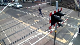 An example of misuse at Lincoln High Street – boy runs across as barriers come down