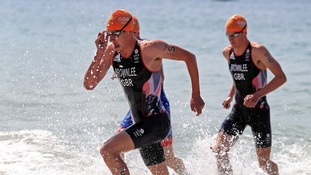 Alistair Brownlee, left, and Jonny were among the leaders after the opening swim.