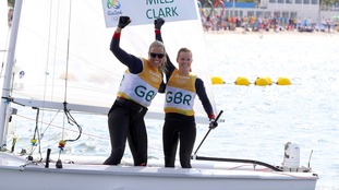 Saskia Clark and Hannah Mills celebrate their gold.