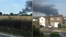 Smoke can be seen billowing above Earls Colne.