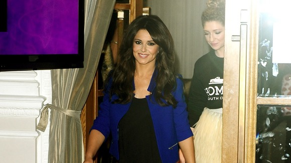Cheryl Cole enters the press conference with the other members of Girls Aloud