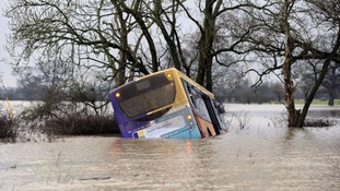Bus driver denies dangerous driving over children rescued from flood water