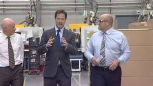 Deputy Prime Minister Nick Clegg, centre, met with staff and apprentices to see how the businesses are using the investments.