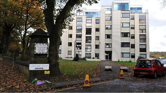 Flowers were laid outside the block of flats after Jimmy Savile&#x27;s death