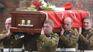 The coffin of Corporal Stephen Allbutt is carried from the Holy Trinity Church, Meir, Stoke-on-Trent in 2003.
