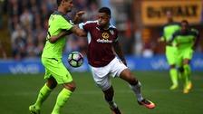 Andre Gray tussles with Liverpool's Dejan Lovren