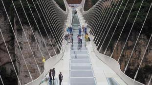 World's 'highest' glass bridge opens in China