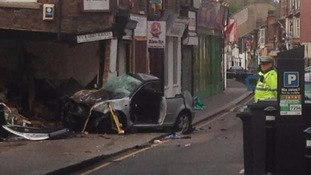 The silver Golf crashed into a shop on High Town Road in Luton