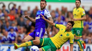 Norwich City's Timm Klose challenges Ipswich Town's Daryl Murphy.