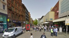 The man was attacked outside TK Maxx on Market Street, Manchester.