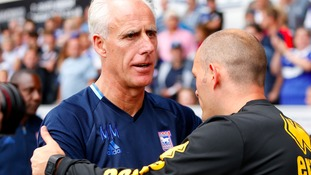 Mick McCarthy and Alex Neil embrace before the game.