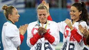 Kate Richardson-Walsh, centre, celebrates winning gold