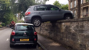 Volkswagen car gets an unusual lift from a Fiat 500