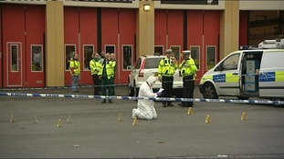 An investigator examines the scene in Cardiff