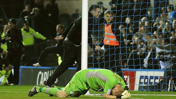 A fan shoved over Chris Kirkland and then ran behind the goal
