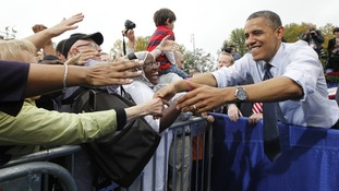 U.S. President Barack Obama greets supporters during a campaign rally in Virginia