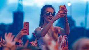 Festival goers enjoying David Guetta's DJ set at V Festival 2016 at Weston Park