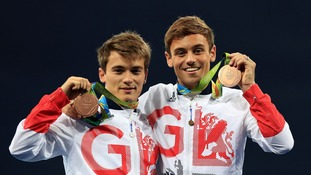 Tom Daley (right) and Daniel Goodfellow (left) celebrate with their bronze medals after the Men's Synchronised 10m Platform Final