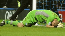 Sheffield Wednesday goalkeeper Chris Kirkland lays on the ground after been struck by a Leeds United fan