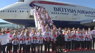 GB Olympians stand for a photo with their medals.