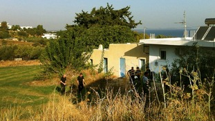 British police officers search for the remains of British boy Ben Needham in an area in the Greek island of Kos