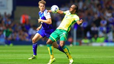 Ipswich Town's Adam Webster and Norwich City's Cameron Jerome (right)