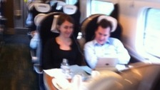 ITV Granada reporter Rachel Townsend managed to get this picture of the Chancellor and his aide on their train from Wilmslow to Euston.