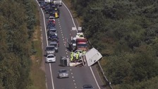 Road closures and delays as caravan overturns