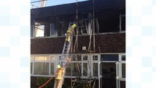 Fire crews were tackling a fire on the roof of a building that's part of the Cecil Jones Academy