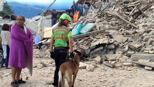 Rescuers search for people trapped under rubble.