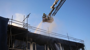 Firefighters tackle the blaze yesterday.