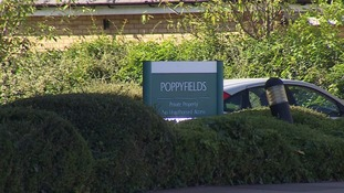 The woman was found dead at Poppyfields at Chapman Way